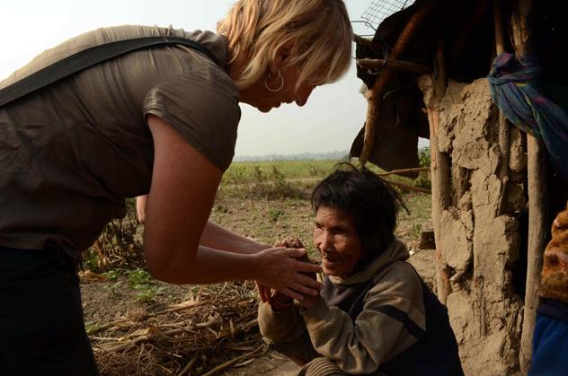 SVPI volunteer helps blind lady in Nepal.