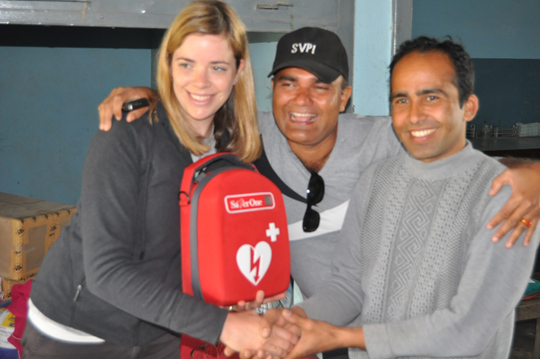 SVPI volunteer, Mirabai donates a defibrillator to a health clinic in a Nepalese village.