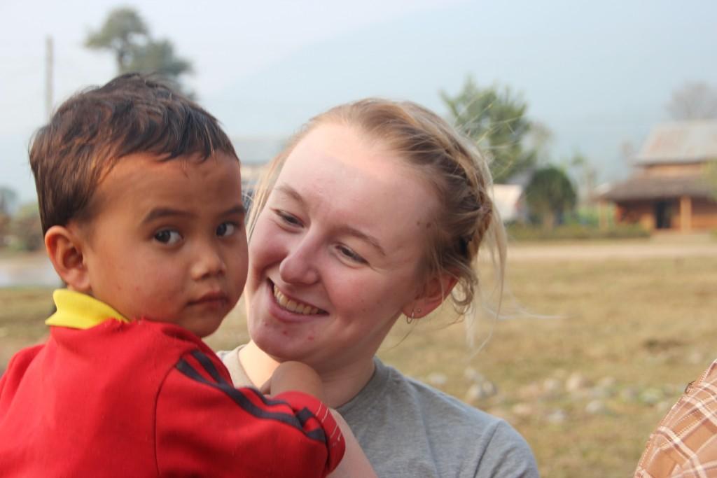 SVPI volunteer with children in Nepal.